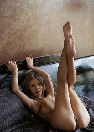 Sexy nubile Ebbi gets hot and masturbates her bald pussy with legs spread wide