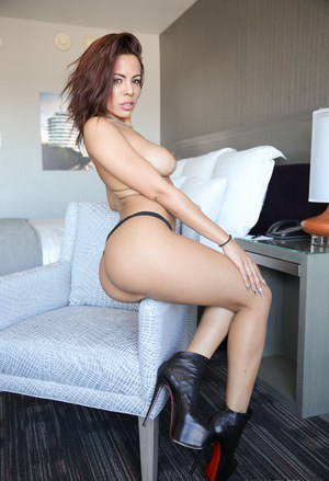 Latina model Luna Star removes leather halter top in Christian Louboutin heels