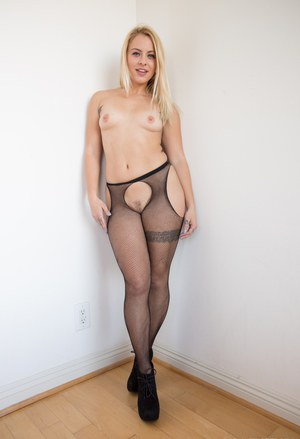 Pornstar Cameron Canada showing off booty in short skirt & fishnet stockings