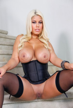 Blonde bombshell Bridgette B free her hooters and ass in black stockings