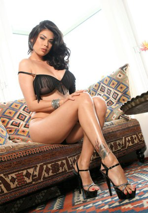 Hot Asian model Tera Patrick uncups big boobs before fingering her pussy