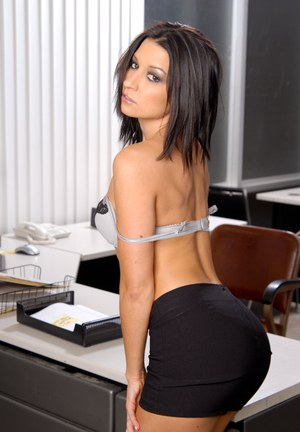 Brunette clothed secretary Ann Marie Rios showing ass in mini skirt