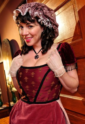 Hot mature brunette RayVeness shows sexy cleavage wearing medieval costume