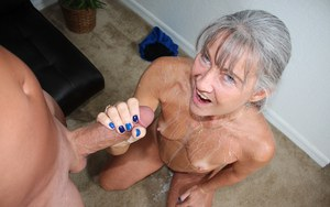 Leilani Lei strips her granny body naked before giving a handjob on knees