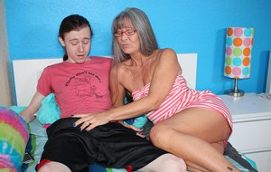 Mature lady with grey hair sucks off her stepson's big penis