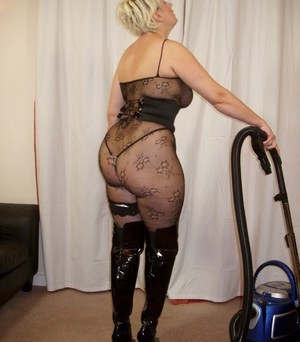 Curvylicious housewife Daniella English vacuuming in fishnets and black boots