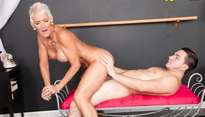 Hot older woman with short hair Lexy Cougar rides her toy boy after dancing
