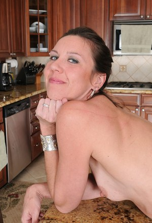 Tall 30 plus female Jizzabelle shows her trimmed pussy on kitchen counter