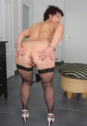 Over 50 housewife Jessica Wild strips to stockings and heels over housework