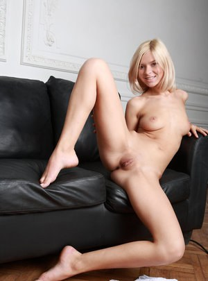 Young looking blonde girl Paloma B slips off lace lingerie to model naked