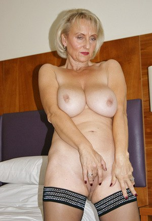 Horny mature lady strips to stockings before delivering a POV blowjob