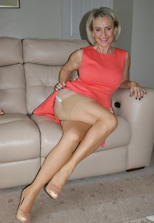 Classy mature Michelle spreading legs for naked upskirt and baring big tits