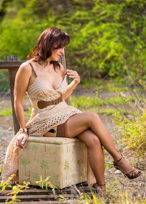 Gorgeous hot mature Roni Ford strips long dress to lie nude on bench outdoors