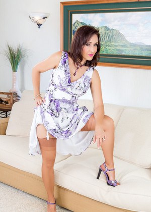 Hot mature woman frees her nylon attired legs from high heeled shoes