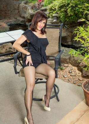 Sexy mature Roni Ford does a sensual patio striptease posing in pantyhose