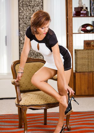 Hot mature lady Roni Ford slips off her short dress and back seam nylons