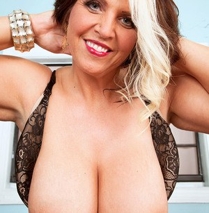 Busty MILF Channel Sweets exposes her giant big tits  models in lace lingerie