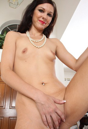 Slim female over 30 wiggles free of her dress and panties to pose nude