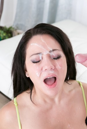 Busty dark haired chick Bambi Diamond taking cumshot on face