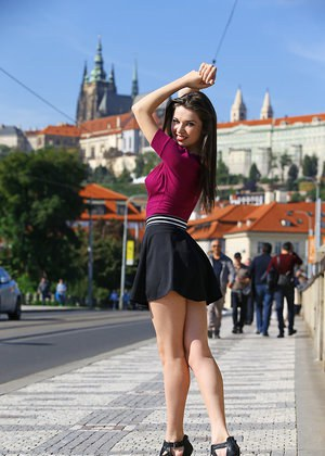 Clothed chick shows off her bare legs in a miniskirt and high heels in public