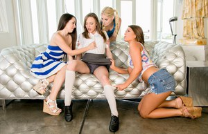 4 amateur teens undress each other for all girl group sex on couch