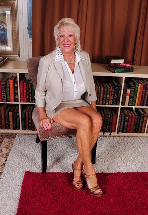 American granny with great legs exposes her huge tits as she gets naked