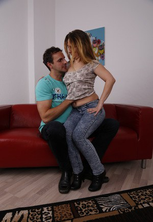 German housewife fools around with her younger love in jeans and boots