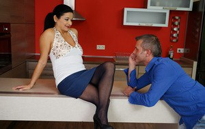 Mature brunette and her lover warm up with foreplay in the kitchen