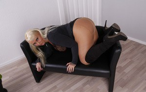 Older mature German wife titty fucks a dildo in lieu of a real cock