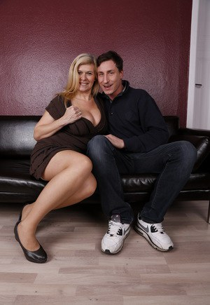 German cougar flashes upskirt panties and stocking tops before sex lessons