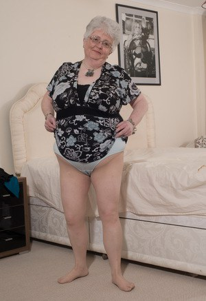 Overweight British grandmother covers her naked boobs with her hands