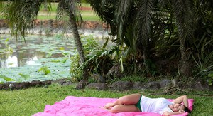 Busty Latina wets herself down in the fountain wearing a white t-shirt