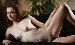 Pale female with red hair Emma Evins sports a creampie on hairy twat after sex