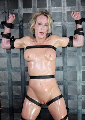 Blonde female Simone Sonay is rendered helpless in a basement dungeon