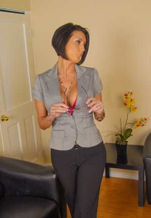 Sexy mature Latina Dylan Ryder fully clothed in hot office seduction