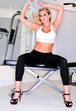 Gorgeous blonde with big tits Alanah Rae posing her hot ass at the gym