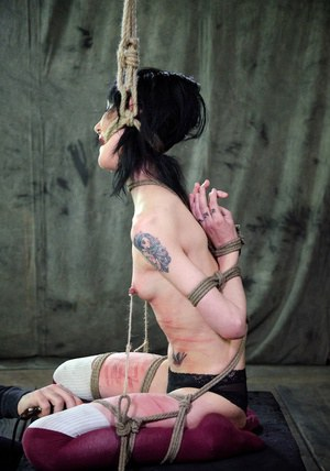 Tiny pain slut Cadence Cross has her ass turned red during extreme bondage
