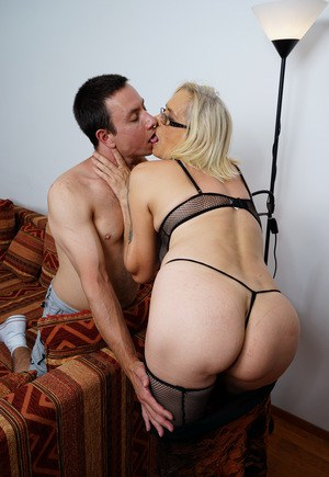 Kinky mature housewife seduces and fucks her toy boy in mesh stockings