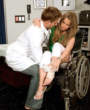 Wheelchair bound Megan Reece giving doctor footjob after cunnilingus