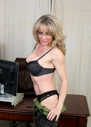 Older mature blonde in glasses and stockings exposing big tits  rubbing pussy