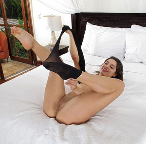 Latina model Carol Luna removes pantyhose before fingering her butthole