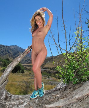 Hot blonde Sheena Shaw removes shorts to toy wet pussy with dildo in field
