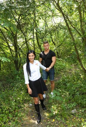 Naught stident in socks and skirt takes her BF to the woods for a blowjob