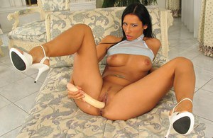 Pierced slut Lora in lace panties toying pussy with dildo wearing high heels
