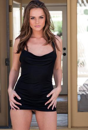 Hot solo model hikes little black dress to expose neatly trimmed bush