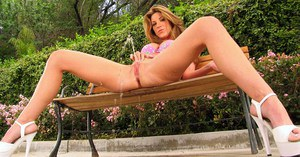 Busty Kayla Paige spreading pussy wide, toying with dildo & squirting in park