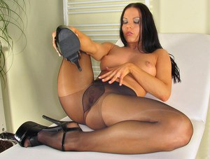 Hot chick Alexia removing pantyhose from long legs before masturbating