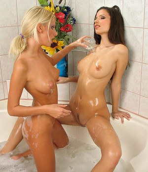 Bute lesbian Bambi with perky nipples bathing with GF fingering wet ass