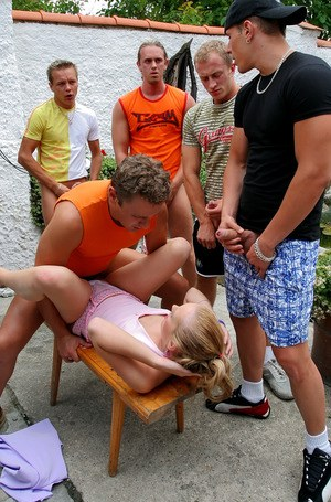 Clothed Euro slut takes on five men during a gangbang on patio