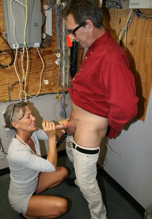 Mature woman Leilani Lei heads into electrical room to jerk off a cock at work